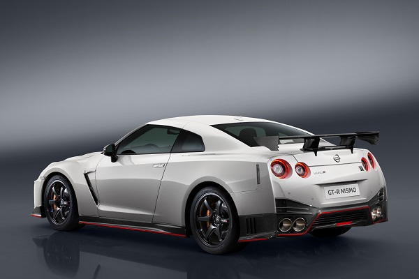 "The 2017 Nissan GT-R NISMO's front end features a freshened face highlighted by an aggressive new fascia. To help cool the car's high-output engine, the dark chrome ""V-motion"" grille has been enlarged to collect more air, without diminishing the car's aerodynamic performance. A new significantly reinforced hood avoids deformation at extremely high speeds, allowing it to keep its aerodynamic shape. Unlike the standard model, the front bumper of the GT-R NISMO – crafted with Takumi-like precision – feature layers of carbon-fiber sheets carefully overlapped to achieve the ideal amount of stiffness."
